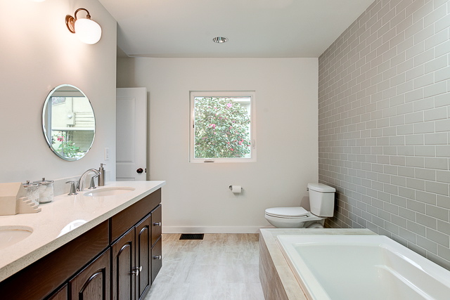 Bath with dual sinks and subway tile