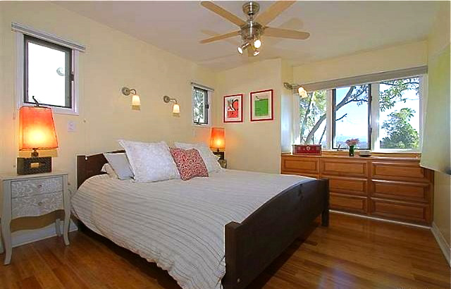 Bright and airy bedroom with original oak floors