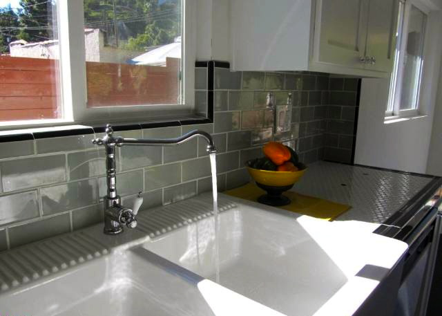 Kitchen with subway tile and hex tile counters