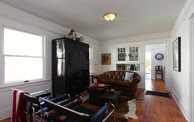 Open living and dining area with vintage built-in sideboard
