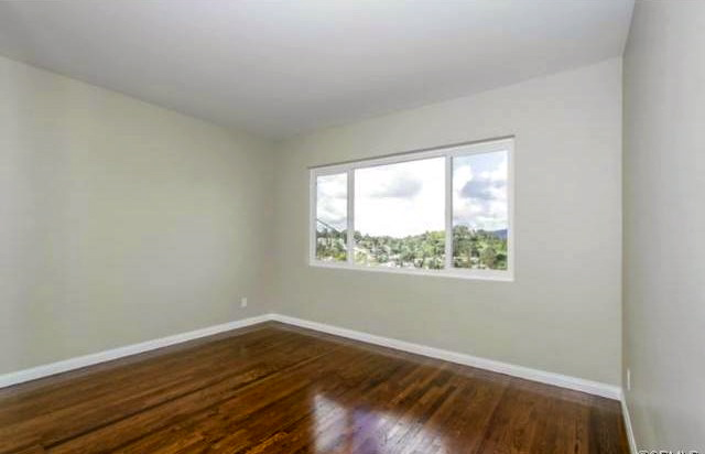 Bedroom with refinished wood floors