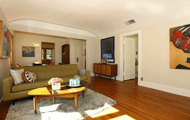 Living room with original wood floors and coved ceilings
