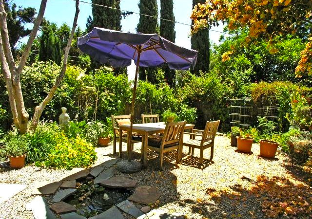 Lush patio. Courtesy of Brian Ades – Sotheby's Int'l Realty