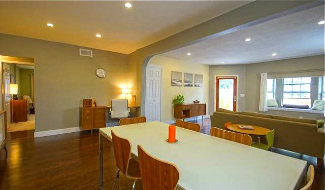 Open living room and dining room with recessed lighting