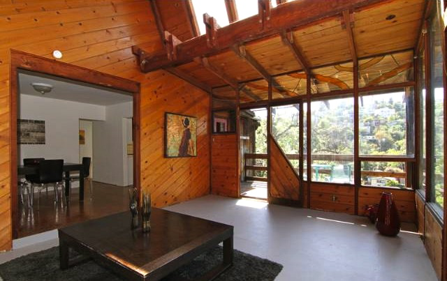 Living room with walls of windows, views and soaring ceilings