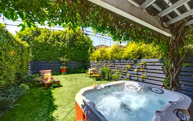 Yard and hot tub. Listing courtesy ofArleen Cohen – Keller Williams