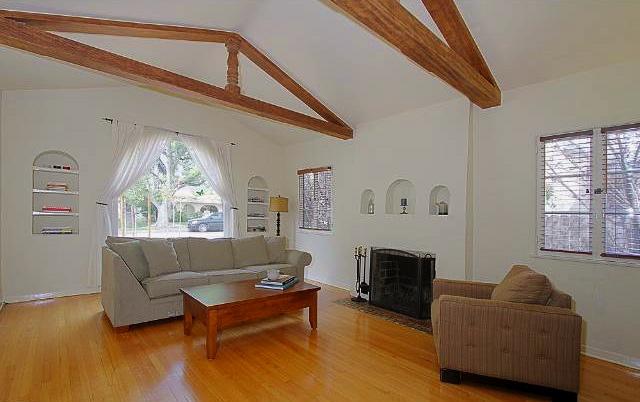 Living room with beamed/vaulted ceiling and fireplace