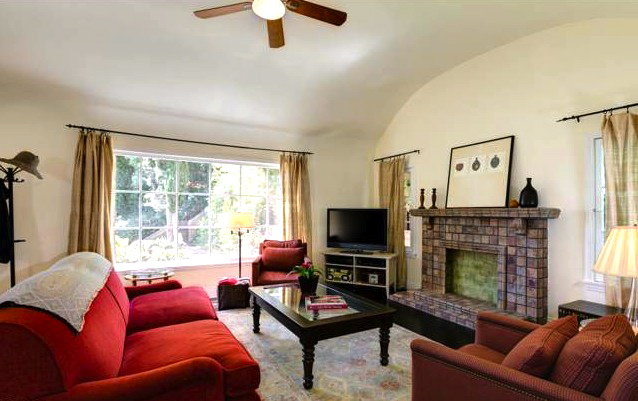 Living room with coved ceilings and original wood floors