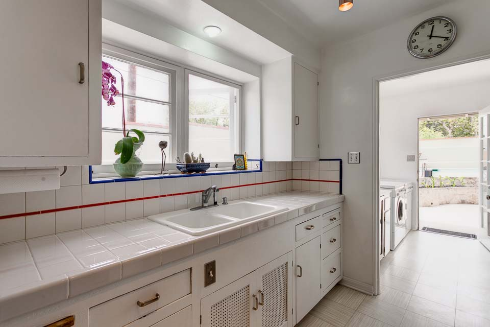 Galley kitchen with built-in cabinets