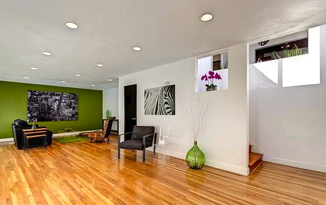 Living room with wood floors and recessed lighting
