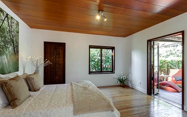 Bedroom with wood ceiling