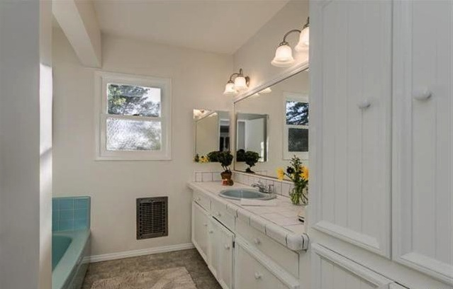Vintage bath with built-in cabinets
