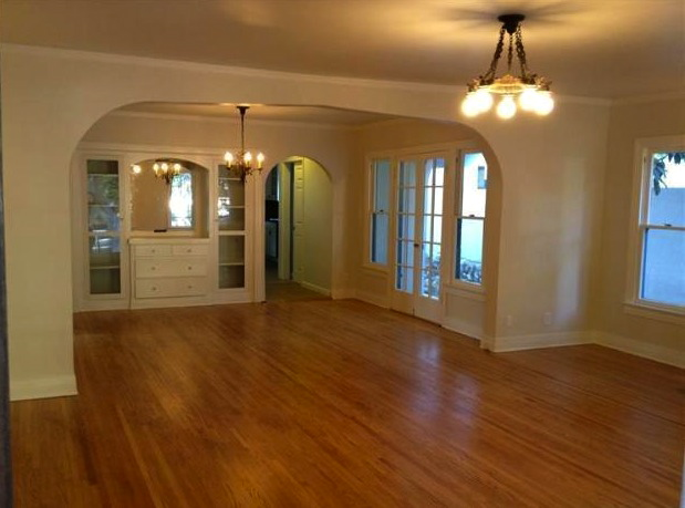 Living room with original wood floors and built-in sideboard