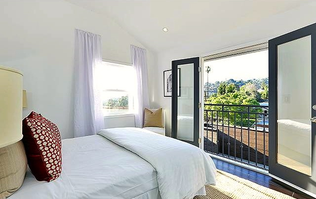 Bedroom with balcony and views