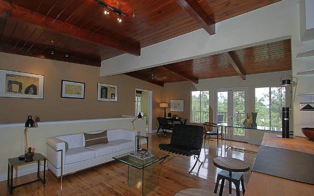 Living room with open floor plan and beamed/vaulted ceilings