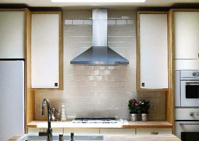 Kitchen with skylight and subway tile backsplash
