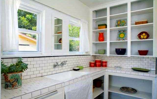 Kitchen with built-in cabinets and subway backsplash