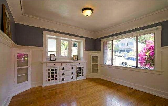 Living room with original wood floors, soffitted ceilings and built-ins
