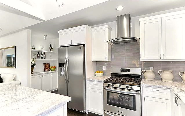Open kitchen with marble counters