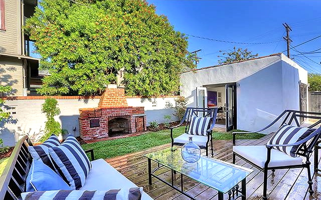 Roomy backyard with deck and outdoor fireplace