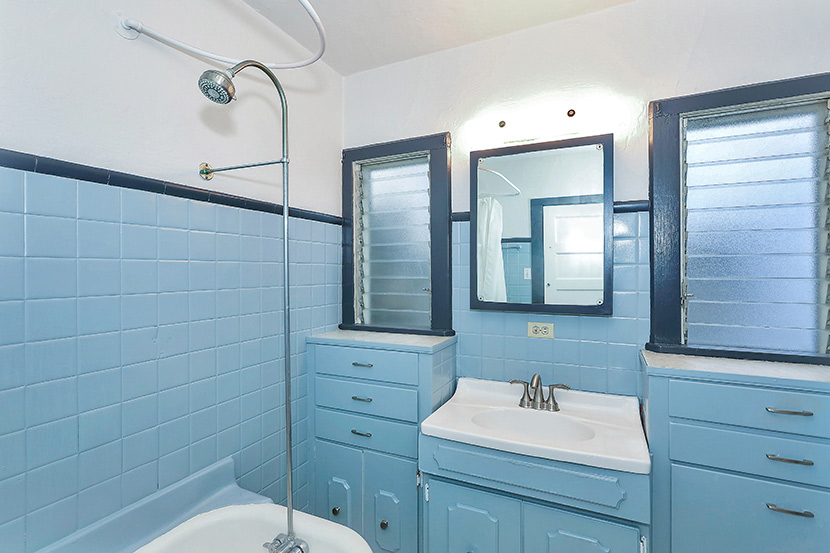 Original bath with clawfoot tub and built-in vanity