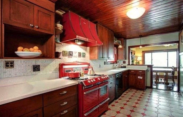 Galley kitchen with vintage O'Keefe & Merritt stove