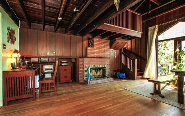 Living room with beamed/vaulted ceilings, fireplace and deck