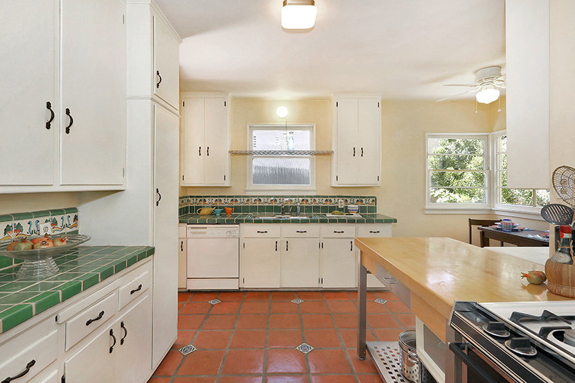 Eat-in kitchen with original built-in cabinets and