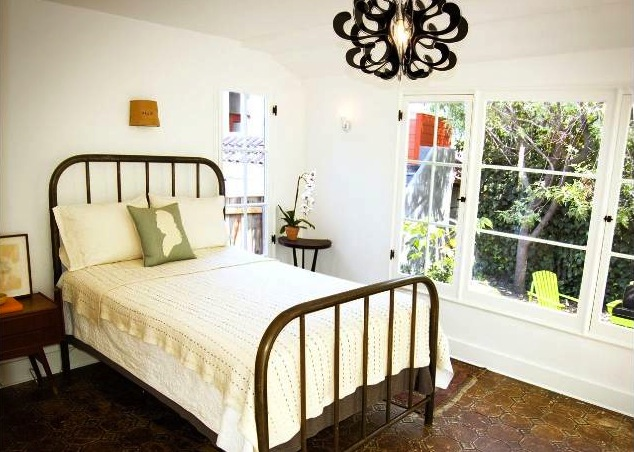 Los Feliz bedroom with a wall of original windows