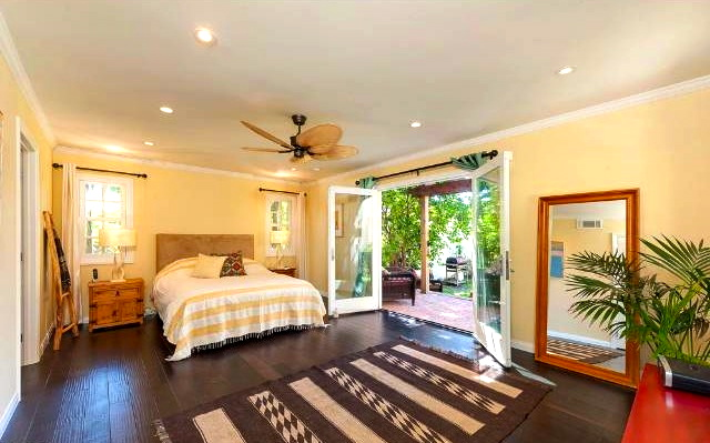 Roomy bedroom with French doors to deck and yard