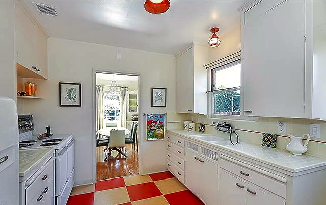 Original built-in galley kitchen with check floors