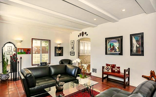 Living room with beamed ceilings and fireplace