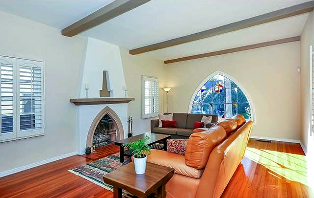 Living room with fireplace and beamed ceiling