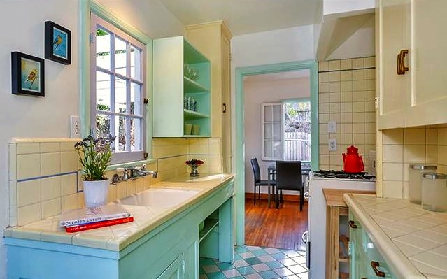 Original kitchen with built-in cabinets