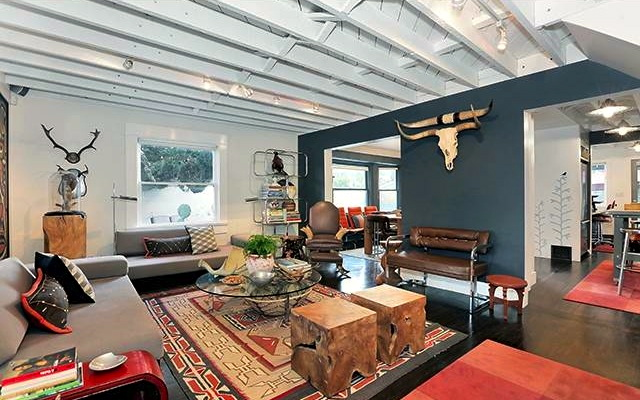 Living room with wood floors and beamed ceiling
