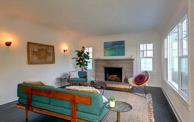 Living room with fireplace, coved ceiling and wood floors