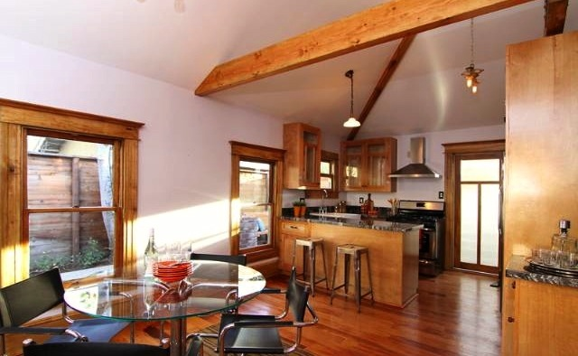 Open floor plan with beamed/vaulted ceiling
