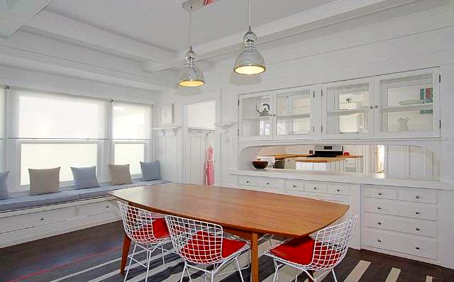 Dining room with built-in sideboard and storage bench