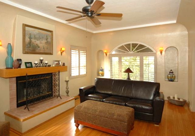 Living room with original wood floors and fireplace