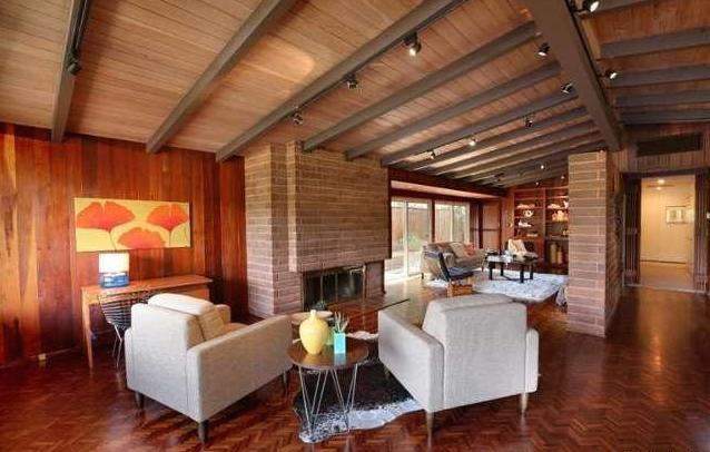 Living room with beamed/vaulted ceilings and fireplace