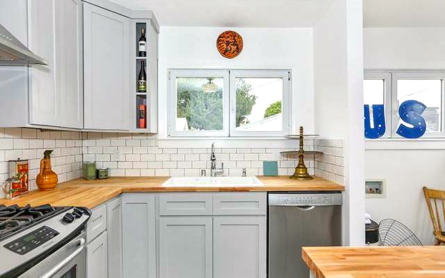 Kitchen with subway backsplash and butcher block counters
