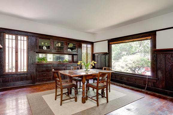 Dining room with picture window and built-in sideboard