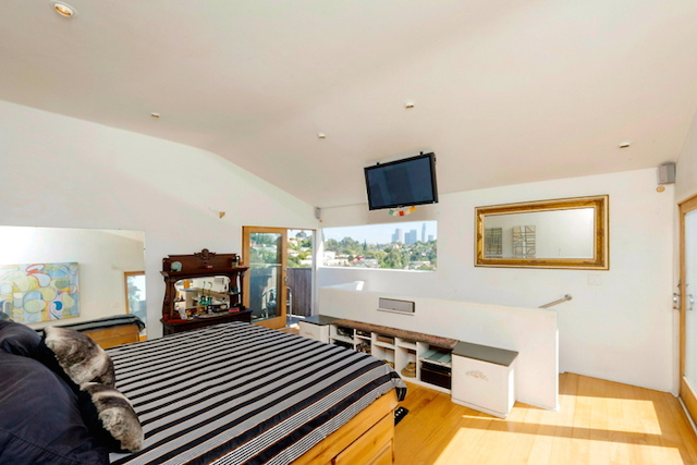 Bedroom with coved ceilings and views