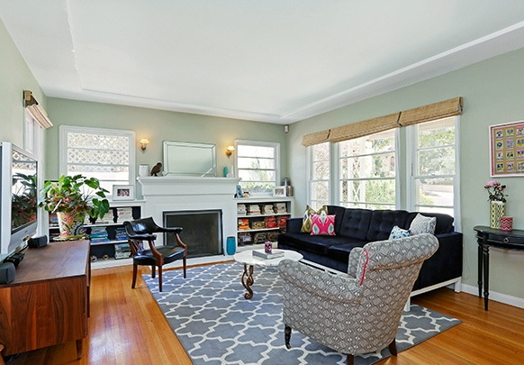Living room with fireplace, original windows and wood floors