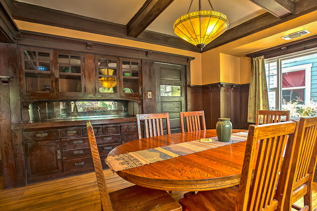 Dining room with built-in sideboard and coffered ceiling