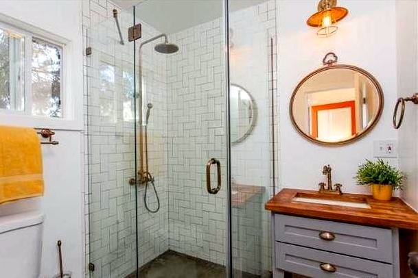 Shower with lattice tile wall and glass enclosure