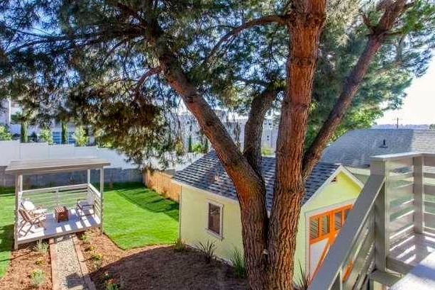 Roomy backyard with pergola