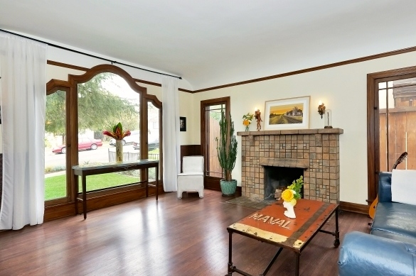 Living room with original wood floors and Batchelder fireplace
