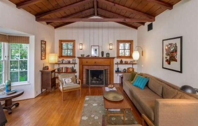 Living room with beamed/vaulted ceilings