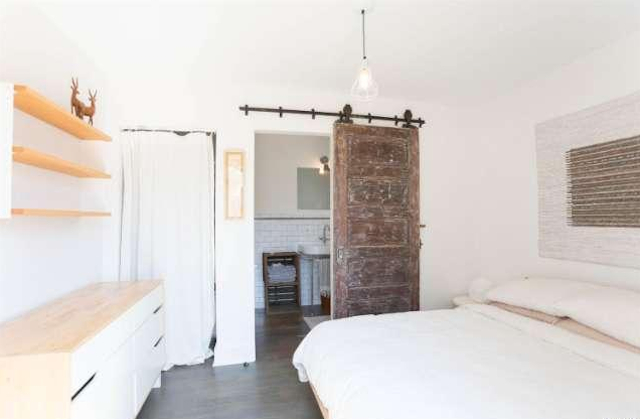 Bedroom with vaulted ceiling